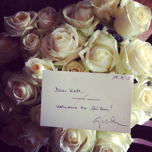 A bunch of long stem white roses and a personal note from Giorgio Armani