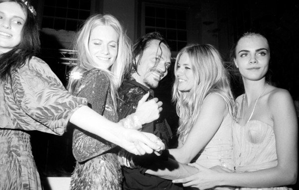 Poppy with friends (including Sienna Miller and her sister Cara).