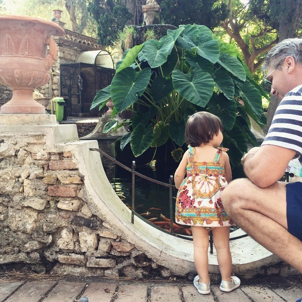 Feeding the fish in Taormina's public gardens.