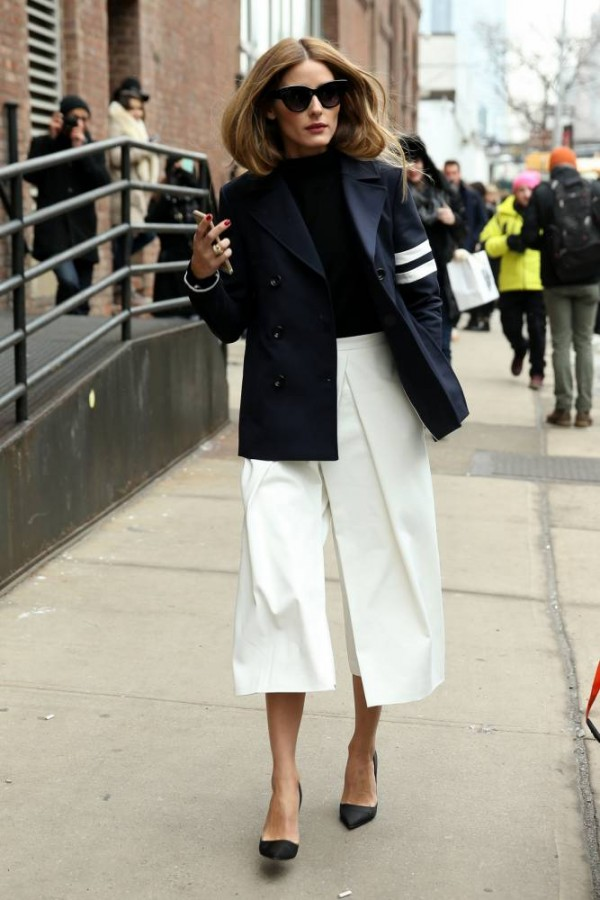 STREET STYLE: Fashion blogger Olivia Palermo, wearing white culotte pants with a navy blazer attends the Tibi fashion show on February 14, 2015 in New York City. Olivia is shown the crosshairs of two photographers! Pictured: Olivia Palermo Ref: SPL951658 140215 Picture by: Christopher Peterson/Splash News Splash News and Pictures Los Angeles: 310-821-2666 New York: 212-619-2666 London: 870-934-2666 photodesk@splashnews.com