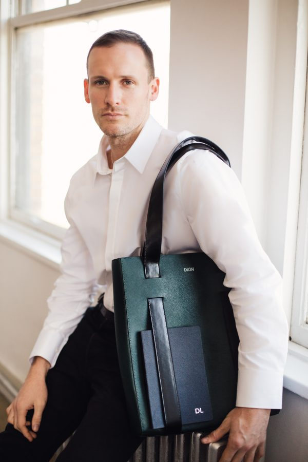 Dion Lee with the tote from his collection with The Daily Edited