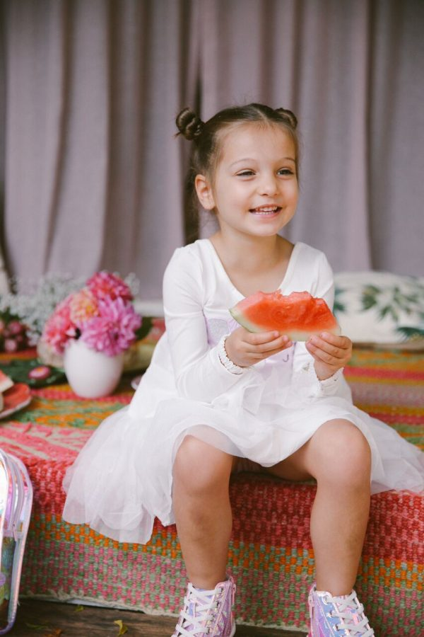 Kate Waterhouse daughter Sophia wearing Seed and eating a watermelon